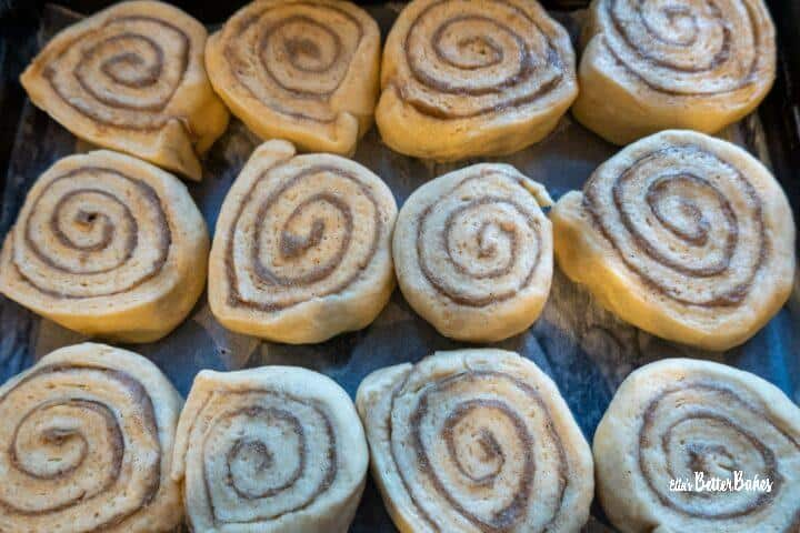 cinnamon buns in baking tray ready to prove