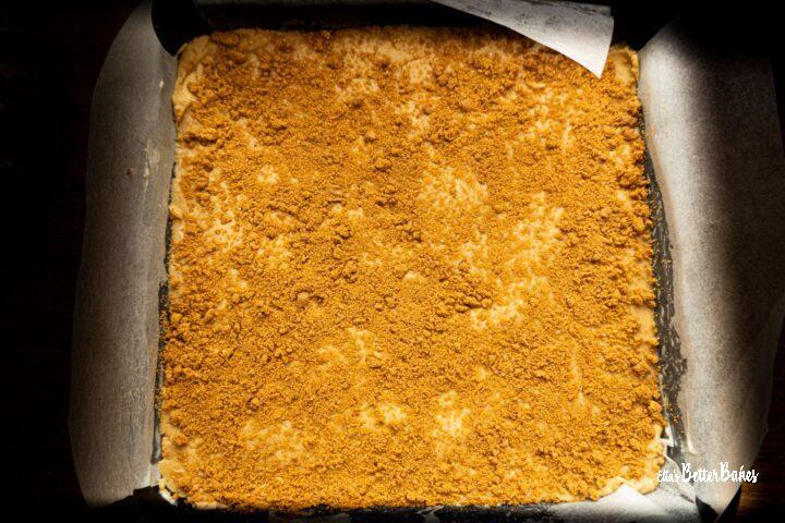 fudge mixture in tin with biscoff