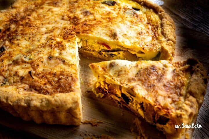 slice of roasted vegetable quiche cut