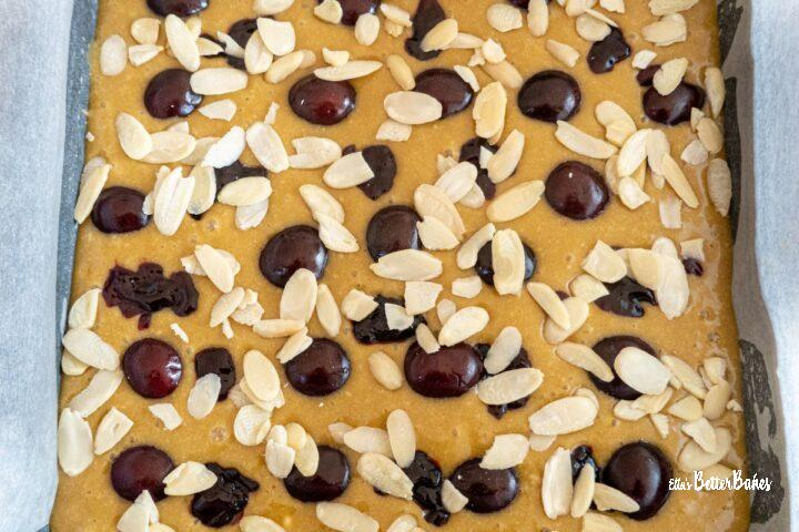 cherry bakewell blondies with flaked amonds added
