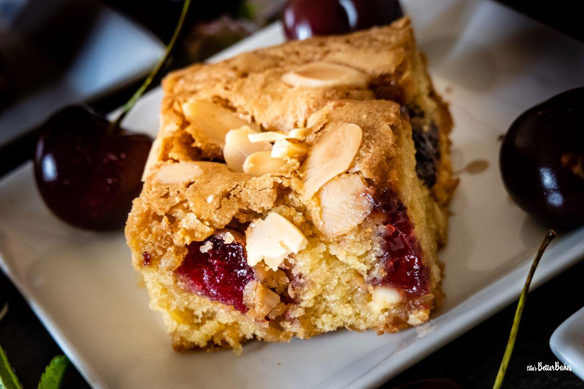 cherry bakewell on a plate with cherries
