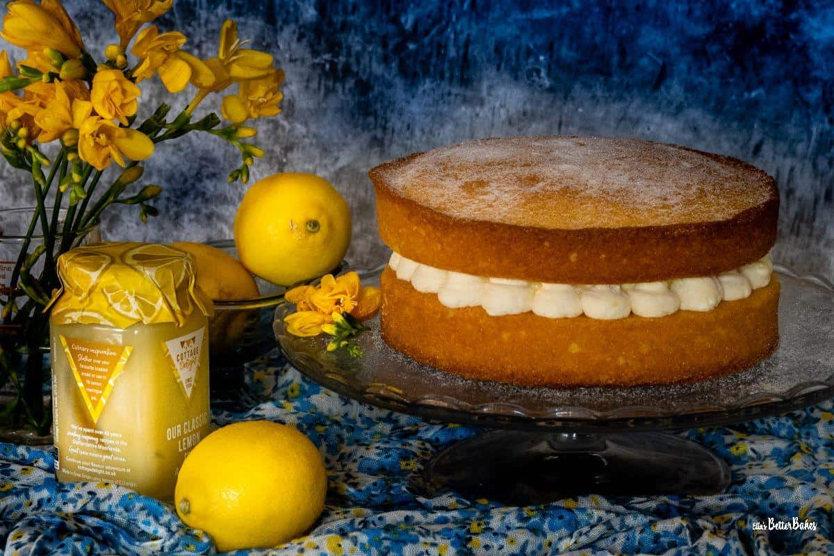 lemon victoria sponge on a cake stand