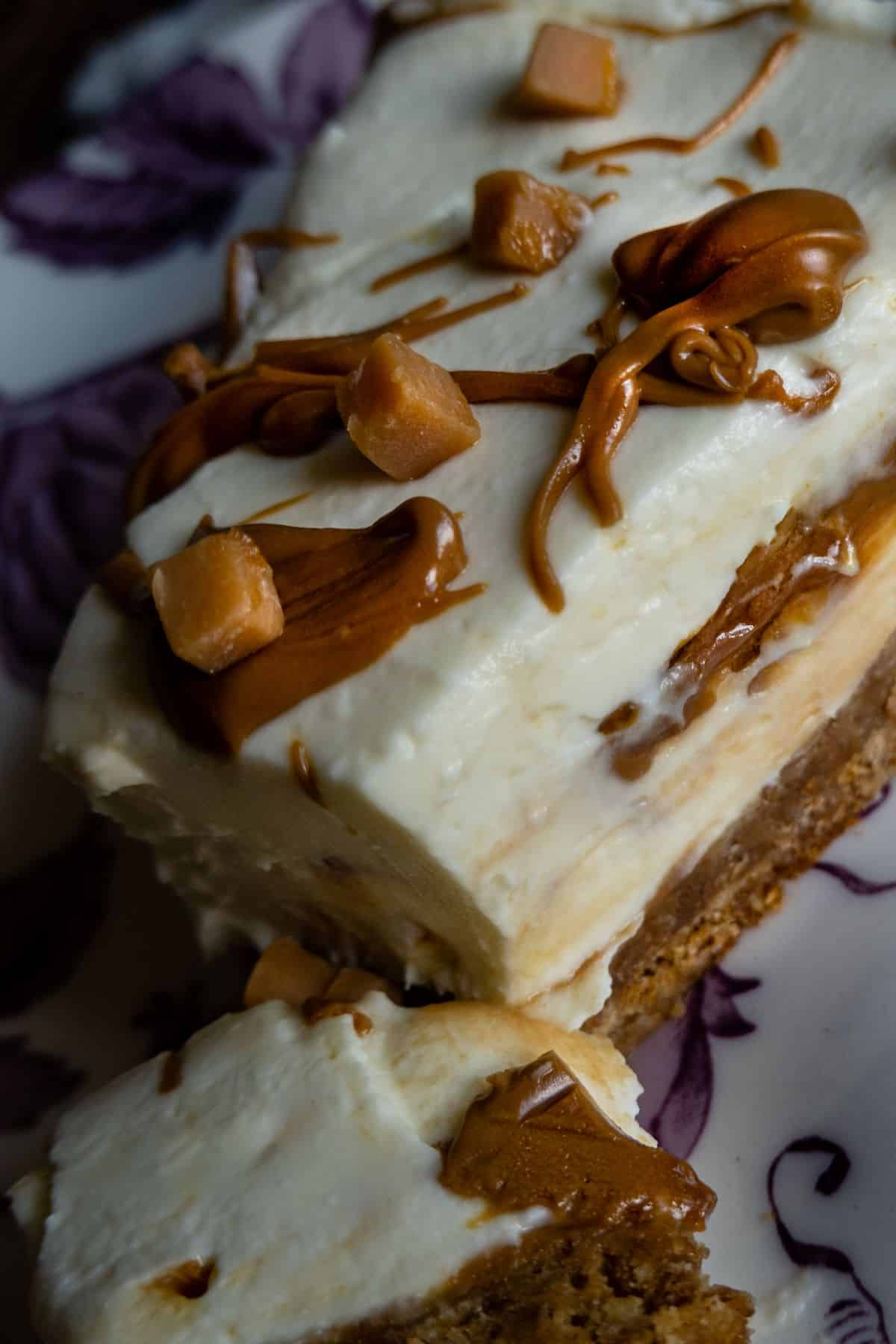 portrait close up of slice salted caramel cheesecake no bake