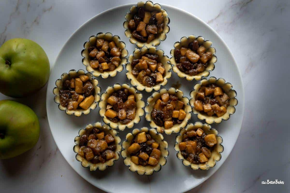 pastry cases filled with apple and sultana mixture