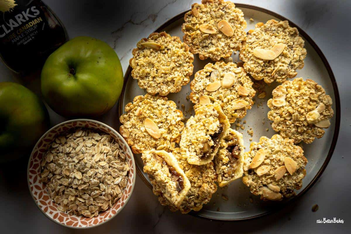plate of apple crumble tartlets next to ingredients