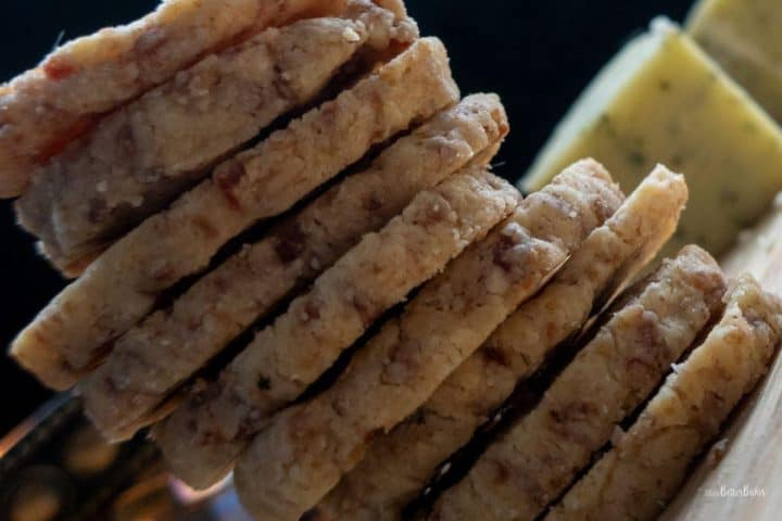 close up of stack mini cheese and ham biscuits